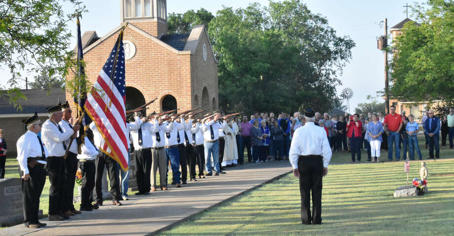 Members of the honor guard of the Francis Wilhelm Memorial American Legion Post 528 of Nazareth fire their traditional three volley salute to the dead from seven rifles prior to the playing of echoing Taps during ceremonies marking Memorial Day at Holy Family Cemetery in Nazareth on Monday, May 27. They joined countrymen in ceremonies across the nation to honor those who fell in service to their country and celebrate those who served and have since passed away. Marking the occasion in such a way dates across many decades in Nazareth. Photo: Jim Steiert/For The Herald
