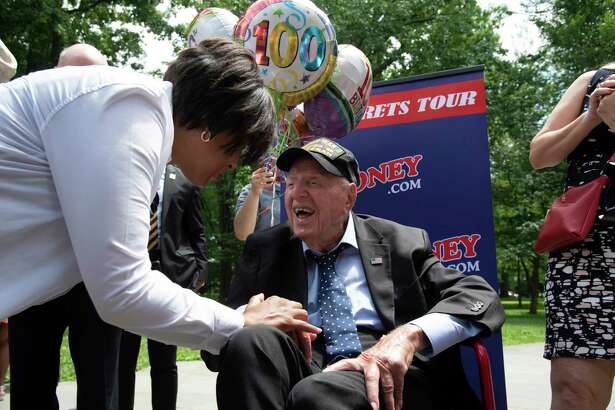 "World War II veteran Sidney Walton, above with District of Columbia Mayor Muriel Bowser, visits the War Memorial in Washington, D.C., on Thursday as he continues his ""The No Regrets Tour."""