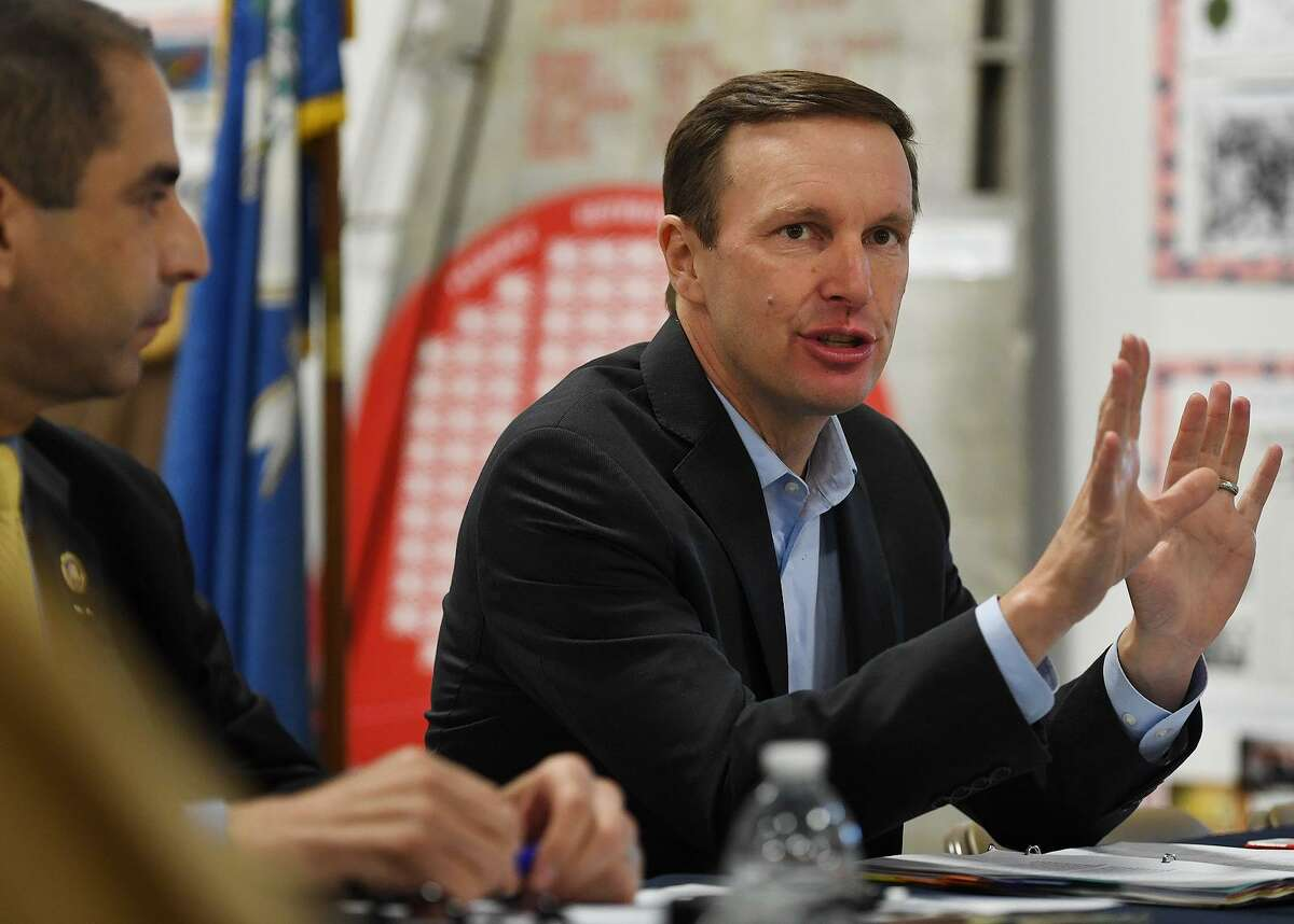 U.S. Sen. Chris Murphy meets with local veterans at the Veterans Museum & Learning Center in West Haven Thursday, May 30, 2019.