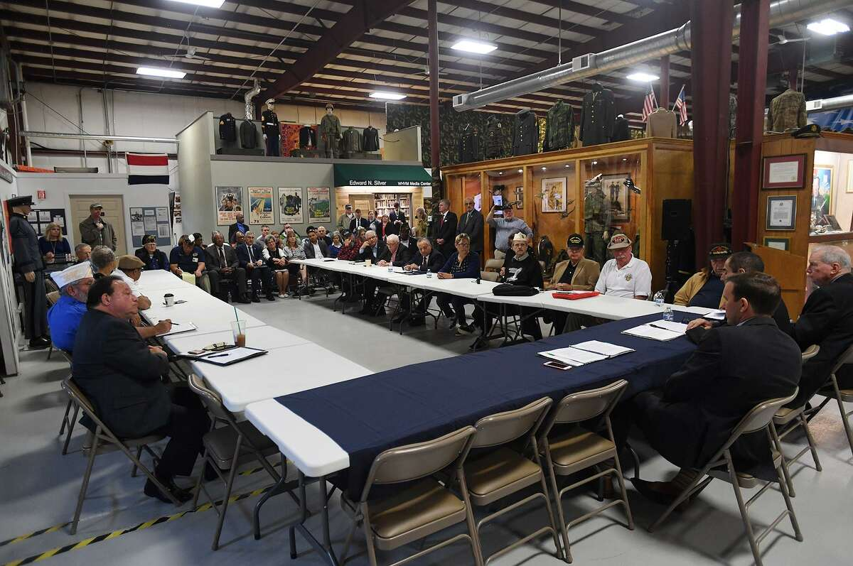 U.S. Sen. Chris Murphy, right, meets with local veterans at the Veterans Museum & Learning Center in West Haven Thursday, May 30, 2019.