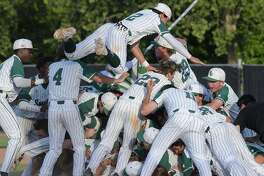 De La Salle-Concord players pile onto each other on the field after winning the�North Coast Section Division I title with a�10-1 defeat of Heritage-Brentwood.