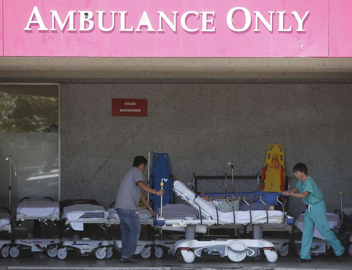 Passengers aboard the Asiana Airlines flight that crashed at San Francisco International Airport arrive at San Francisco General Hospital on Saturday, July 6, 2013 in San Francisco, Calif.