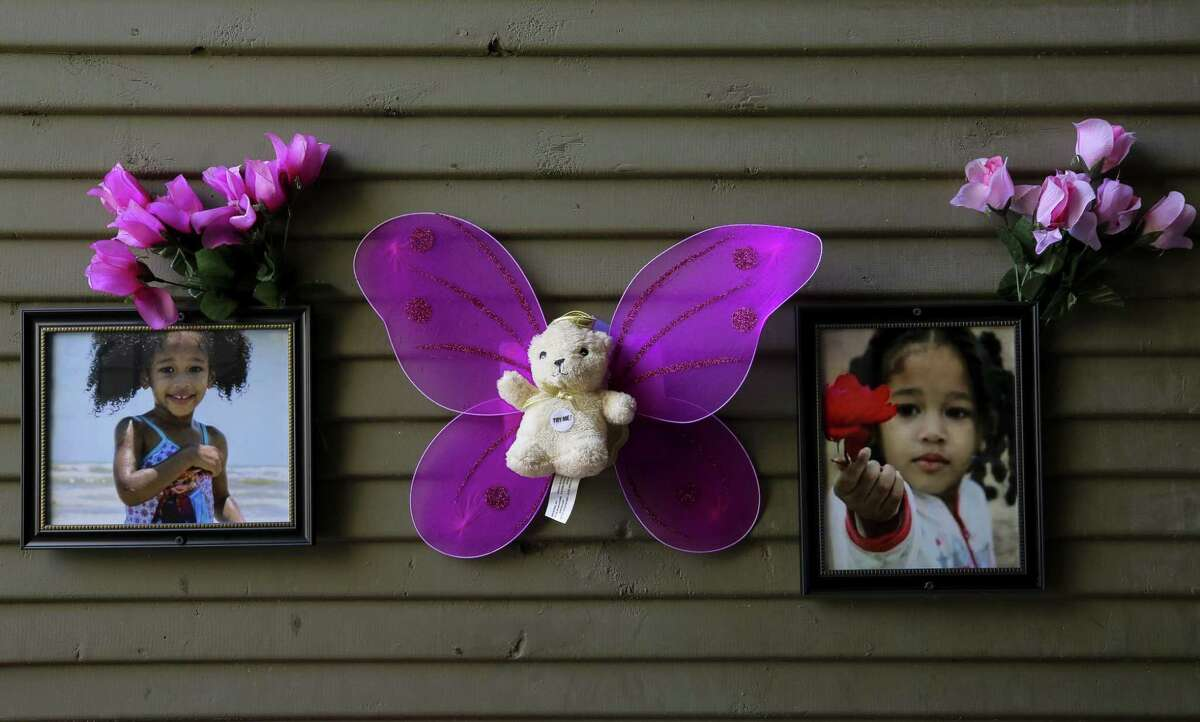 Balloons, flowers, and stuffed animals fill the entrance to Maleah Davis' family apartment Monday, May 20, 2019, in Houston. Maleah has been missing since early May, after her mother's boyfriend, Darien Vence, reported that she was abducted by three men. Police said that story later fell apart, and Vence is now accused of tampering with a corpse after blood linked to Maleah was found in his southwest Houston apartment.