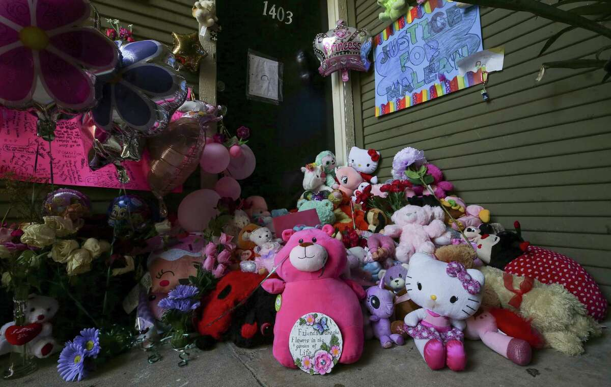 Balloons, flowers, and stuffed animals fill the entrance to Maleah Davis' apartment Monday, May 20, 2019, in Houston. Maleah has been missing since early May, after her mother's boyfriend, Darien Vence, reported that she was abducted by three men. Police said that story later fell apart, and Vence is now accused of tampering with a corpse after blood linked to Maleah was found in his southwest Houston apartment.