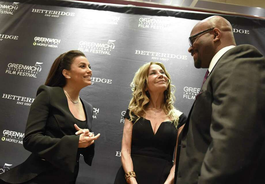 Actress Eva Longoria Bastón, left, television host Kathie Lee Gifford, and Boys & Girls Club of Greenwich CEO Bobby Walker Jr. chat at the Greenwich International Film Festival Changemaker Gala Meet & Greet cocktail reception at Betteridge Jewelers Thursday. Photo: Tyler Sizemore / Hearst Connecticut Media / Greenwich Time