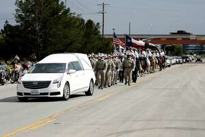 The funeral procession travels on Highway 349 north of Loop 250 to enter Resthaven Memorial Park for the funeral of Midland County Sheriff Gary Painter May 30, 2019.  James Durbin/Reporter-Telegram