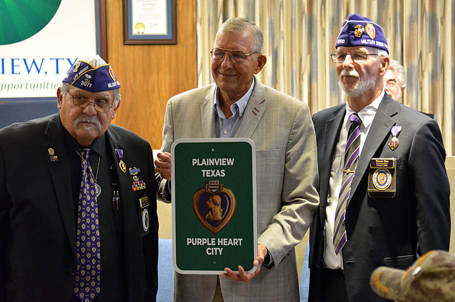 Mayor Wendell Dunlap proclaims Plainview to be a Purple Heart City during a presentation at City Council this week. Photo: Nathan Giese/Plainview Herald