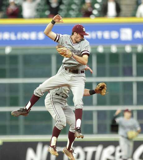 Texas Aggies infielder Braden Shewmake (8) and Texas Aggies infielder Bryce Blaum (15) celebrate after Texas Aggies deafeated Houston Cougars in the 2019 Shriners College Classic at Minute Maid Park, Sunday, March 3, 2019, in Houston.