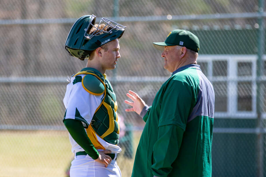 Dow High baseball coach Rich Juday talks with catcher Michael Erickson during a game earlier this season. Photo: Photo Provided (AnneMarie Erickson)