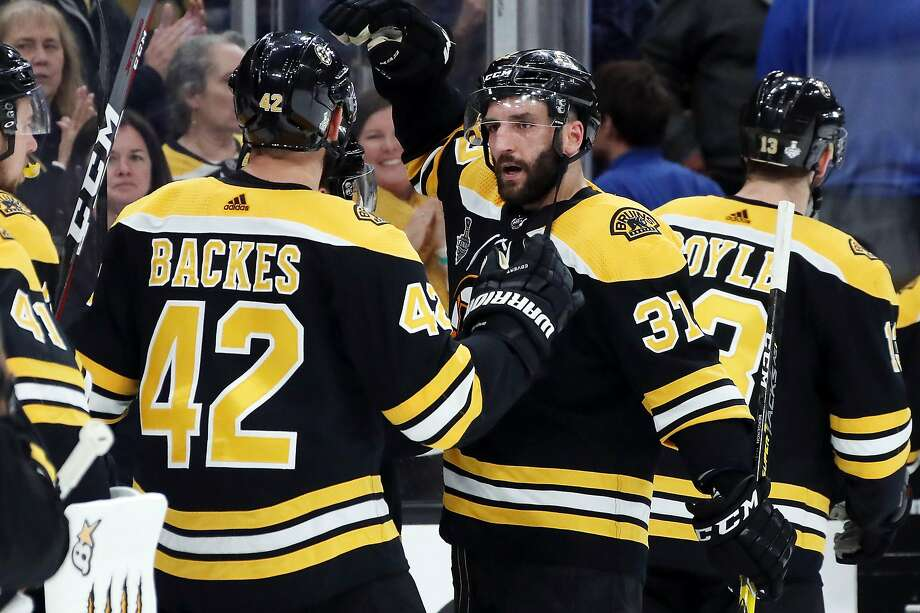 Patrice Bergeron #37 of the Boston Bruins celebrate their teams 4-2 win over the St. Louis Blues in Game One of the 2019 NHL Stanley Cup Final at TD Garden on May 27, 2019 in Boston, Massachusetts. (Photo by Bruce Bennett/Getty Images) Photo: Bruce Bennett / Getty Images