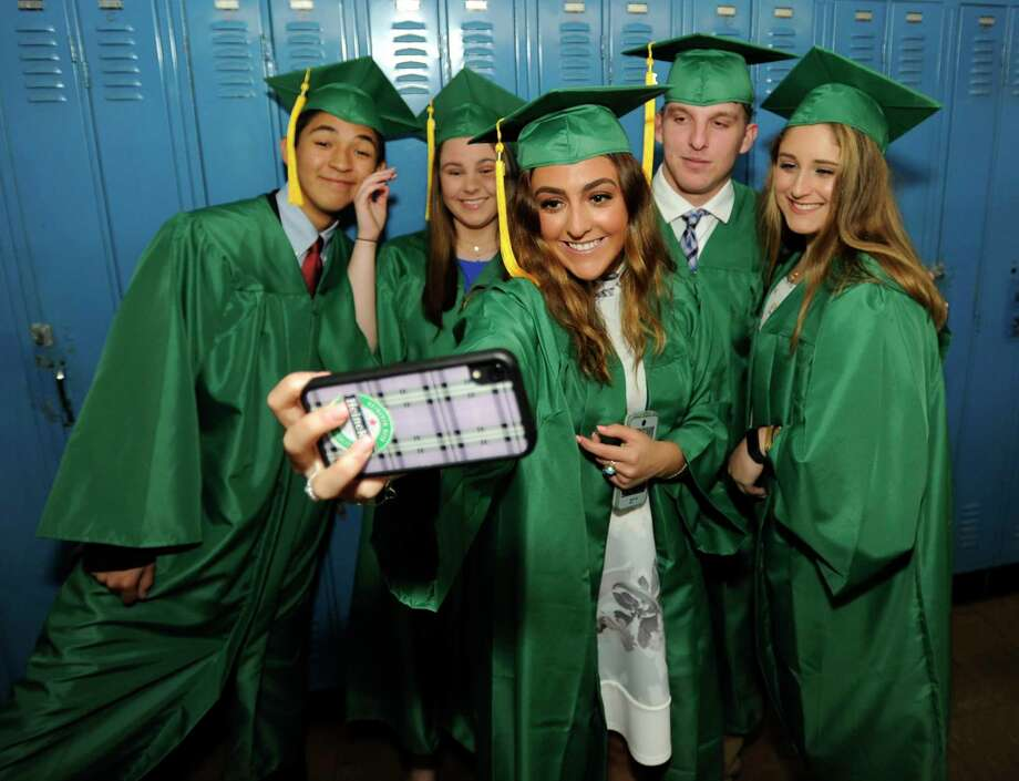 Julianna Fauci snaps a selfie with friends prior to Trinity Catholic High School Class of 2019 commencement exercises on May 30, 2019 in Stamford, Connecticut. Photo: Matthew Brown, Hearst Connecticut Media / Stamford Advocate