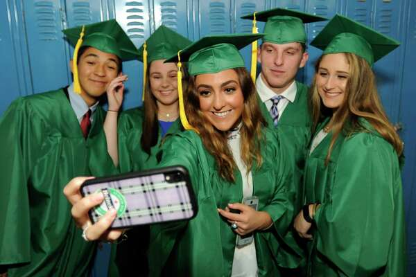 Julianna Fauci snaps a selfie with friends prior to Trinity Catholic High School Class of 2019 commencement exercises on May 30, 2019 in Stamford, Connecticut.