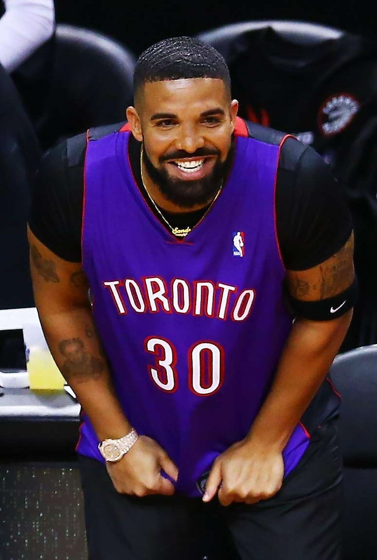 Rapper Drake is seen wearing a Dell Curry jersey before Game One of the 2019 NBA Finals between the Golden State Warriors and the Toronto Raptors at Scotiabank Arena on May 30, 2019 in Toronto.