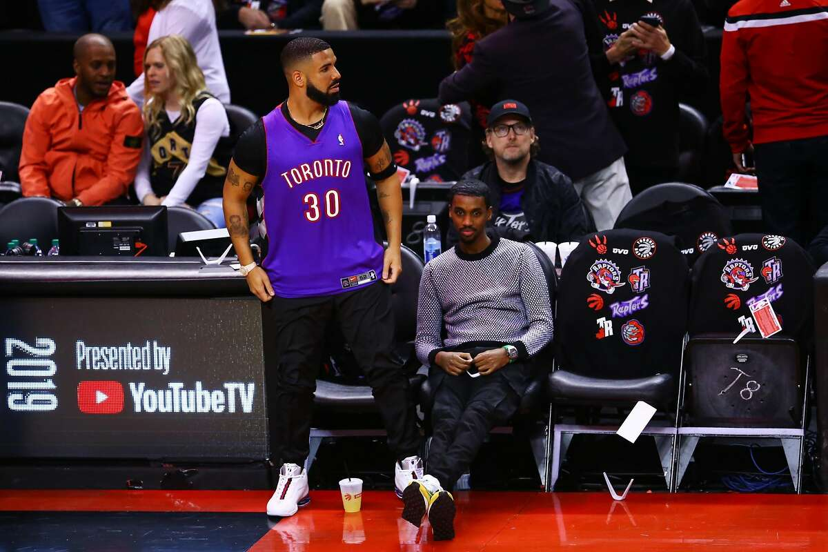 Drake is seen wearing a Dell Curry jersey before Game One of the 2019 NBA Finals between the Golden State Warriors and the Toronto Raptors at Scotiabank Arena on May 30, 2019.