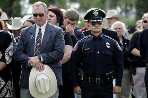 Midland County Sheriff's Office Chief Deputy Rory McKinney, left, and Midland Police Department Chief Seth Herman, right, look on during the funeral for Midland County Sheriff Gary Painter May 30, 2019 at Resthaven Memorial Park.  James Durbin/Reporter-Telegram