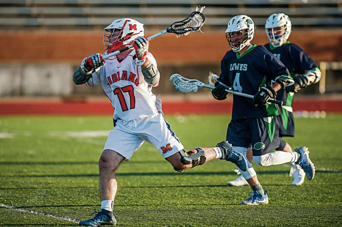 Midland boys' lacrosse player Ryan Sisitki takes a shot during a game against Saginaw Heritage earlier this season.