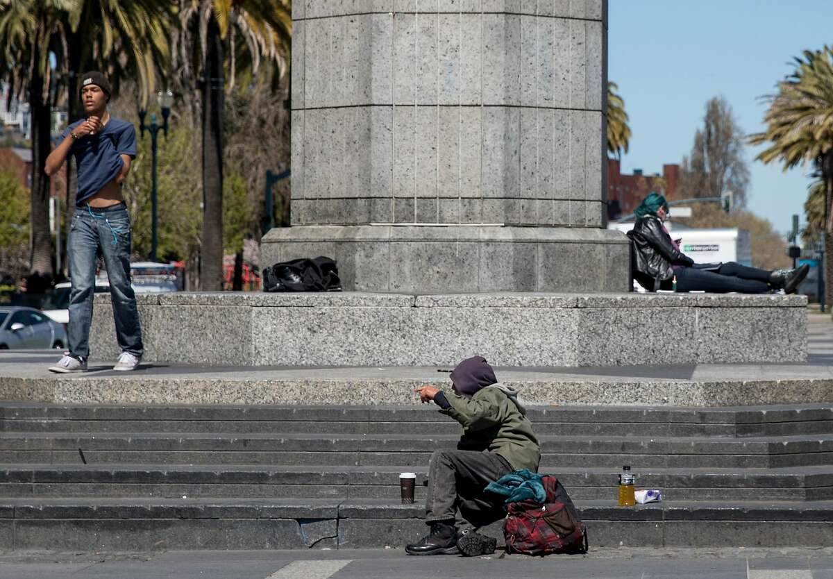 A homeless man sits on the steps of Harry Bridges Plaza along the Embarcadero in San Francisco, Calif. Sunday, April 7, 2019.