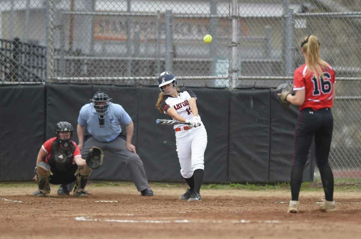 Stamford's Jordan Rossi hits a two-run homer in the bottom of the fifth inning against Fairfield Warde in a second round game of the CIAC Class LL Softball Tournament at Stamford High School on May 30, 2019 in Stamford, Connecticut. Stamford won 8-3.