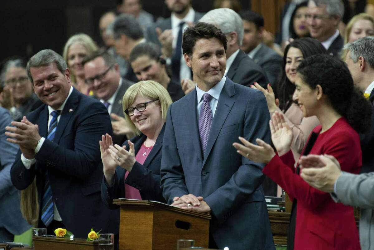 Canadian Prime Minister Justin Trudeau receives applause following a speech on the USMCA trade agreement in the House of Commons in Ottawa, Ontario, Wednesday, May 29, 2019. (Adrian Wyld/The Canadian Press via AP)