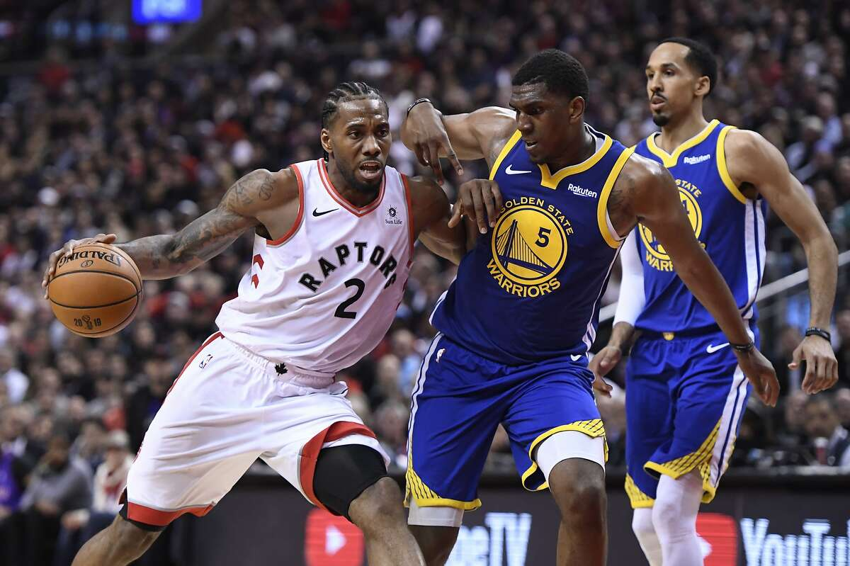 Toronto Raptors forward Kawhi Leonard (2) drives as Golden State Warriors center Kevon Looney (5) defends during the second half of Game 1 of basketball's NBA Finals, Thursday, May 30, 2019, in Toronto. (Frank Gunn/The Canadian Press via AP)