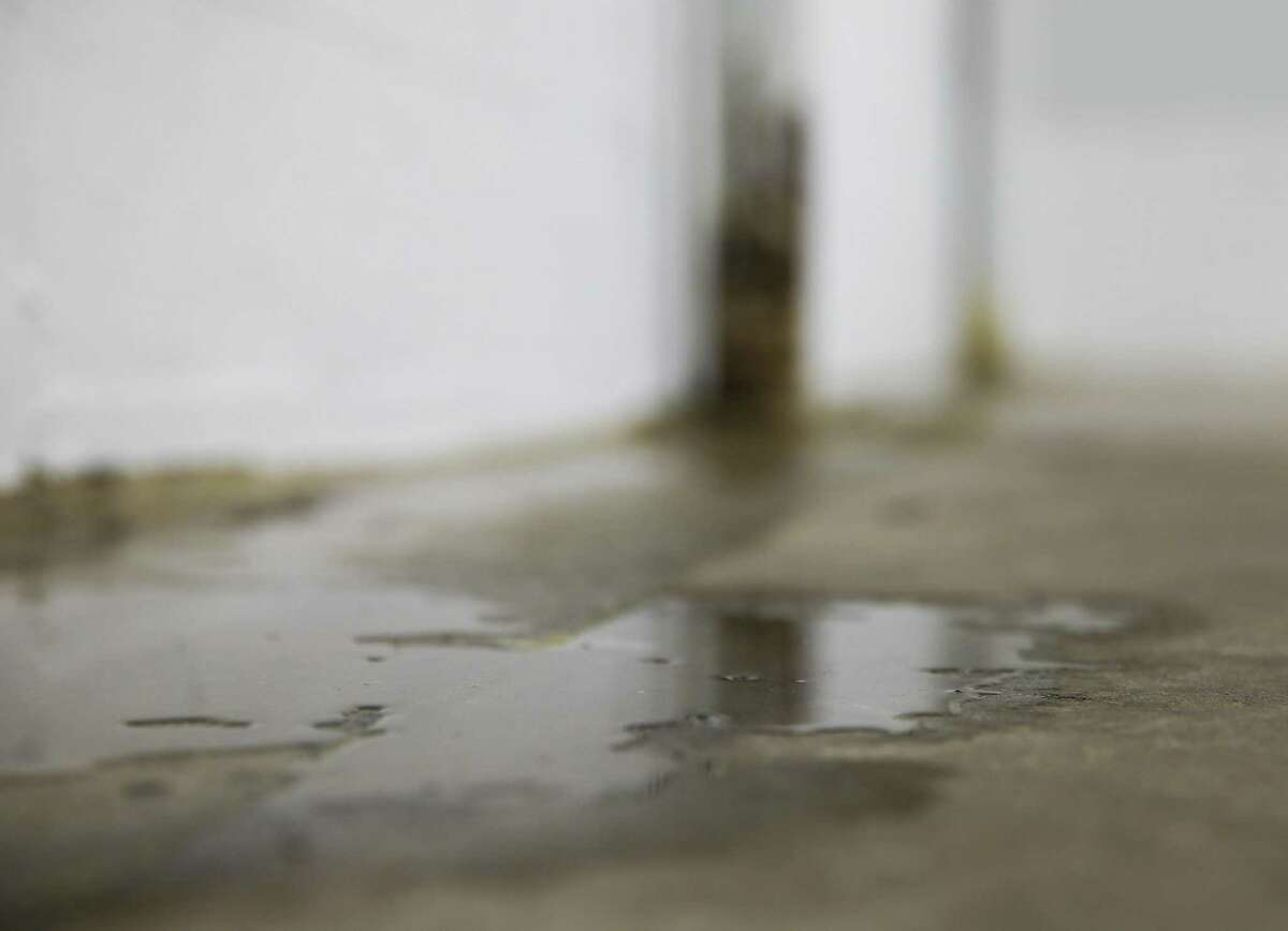 Water sits in one of the studios at METdance performers rehearse on Tuesday, May 28, 2019 in Houston. The company, which is the second-largest professional dance company and school in Houston, is being evicted from their current studio.
