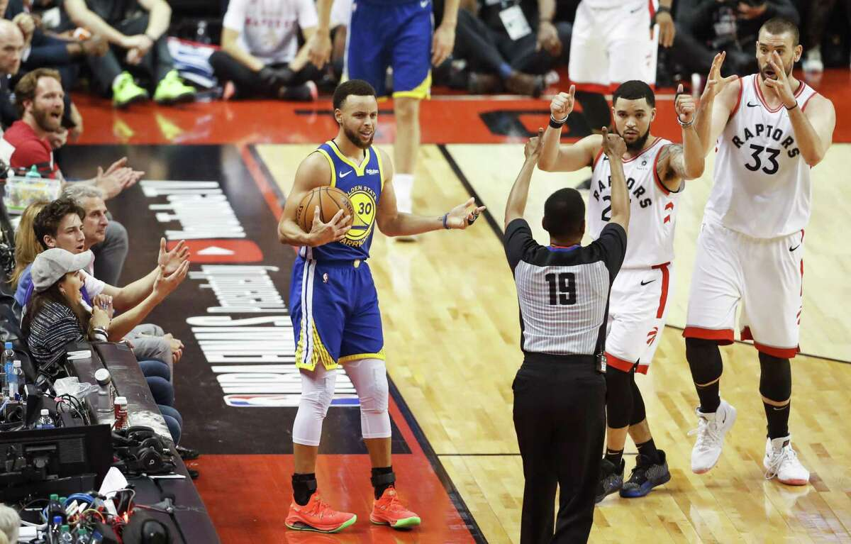 Golden State Warriors' Stephen Curry and Toronto Raptors' Fred VanVleet and Marc Gasol react to a foul call against Curry in the second quarter during game 1 of the NBA Finals between the Golden State Warriors and the Toronto Raptors at Scotiabank Arena on Thursday, May 30, 2019 in Toronto, Ontario, Canada.