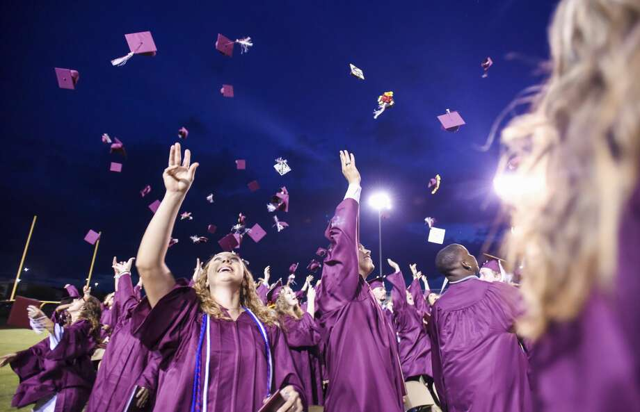 Students throw their caps into the air at the end of Silsbee's graduation ceremony Thursday night. While the ceremony ended up being outside administrators earlier in the day were planning on having it inside. Photo taken on Thursday, 05/30/19. Ryan Welch/The Enterprise Photo: Ryan Welch/The Enterprise