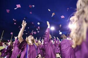 Students throw their caps into the air at the end of Silsbee's graduation ceremony Thursday night. While the ceremony ended up being outside administrators earlier in the day were planning on having it inside. Photo taken on Thursday, 05/30/19. Ryan Welch/The Enterprise