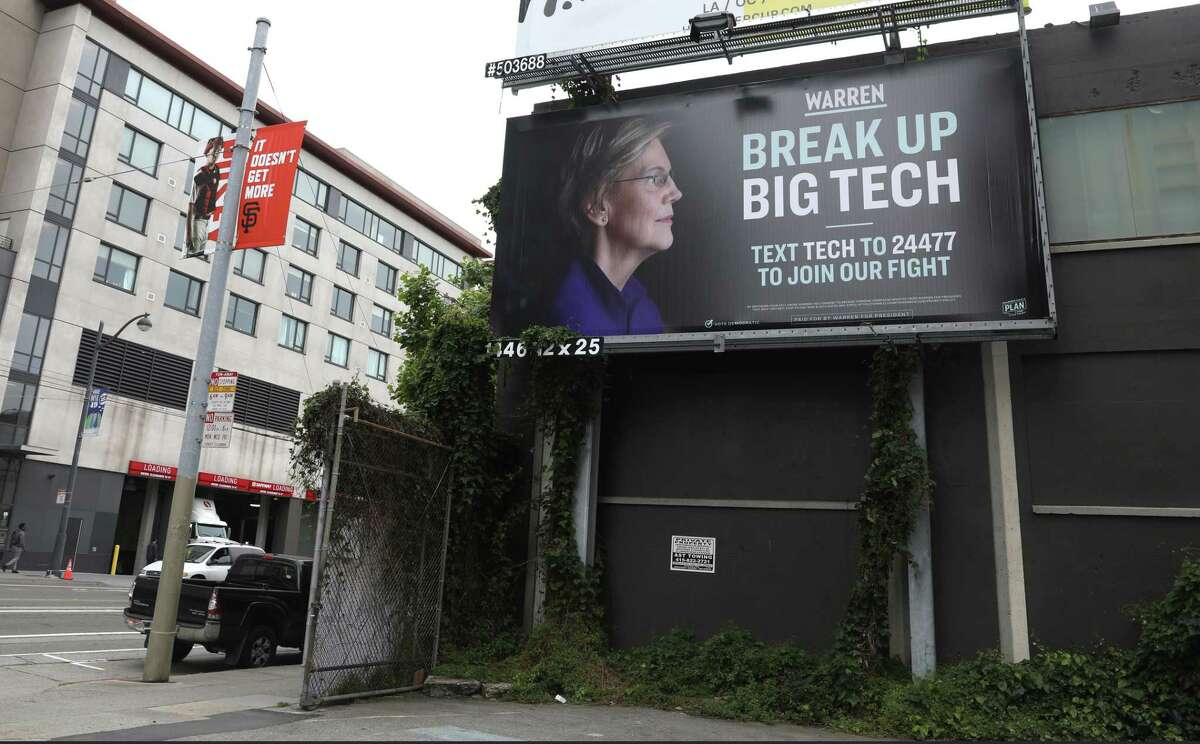 """At Fourth on Townsend streets is a billboard showing Elizabeth Warren that says, """"Warren. Break up big tech,"""" seen on Thursday, May 30, 2019 in San Francisco, Calif."""