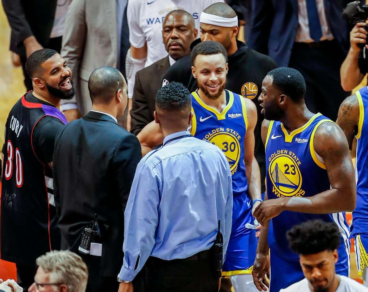 Drake and Golden State Warriors' Draymond Green have words after the Warriors' 118 to 109 loss in game 1 of the NBA Finals between the Golden State Warriors and the Toronto Raptors at Scotiabank Arena on Thursday, May 30, 2019 in Toronto, Ontario, Canada.