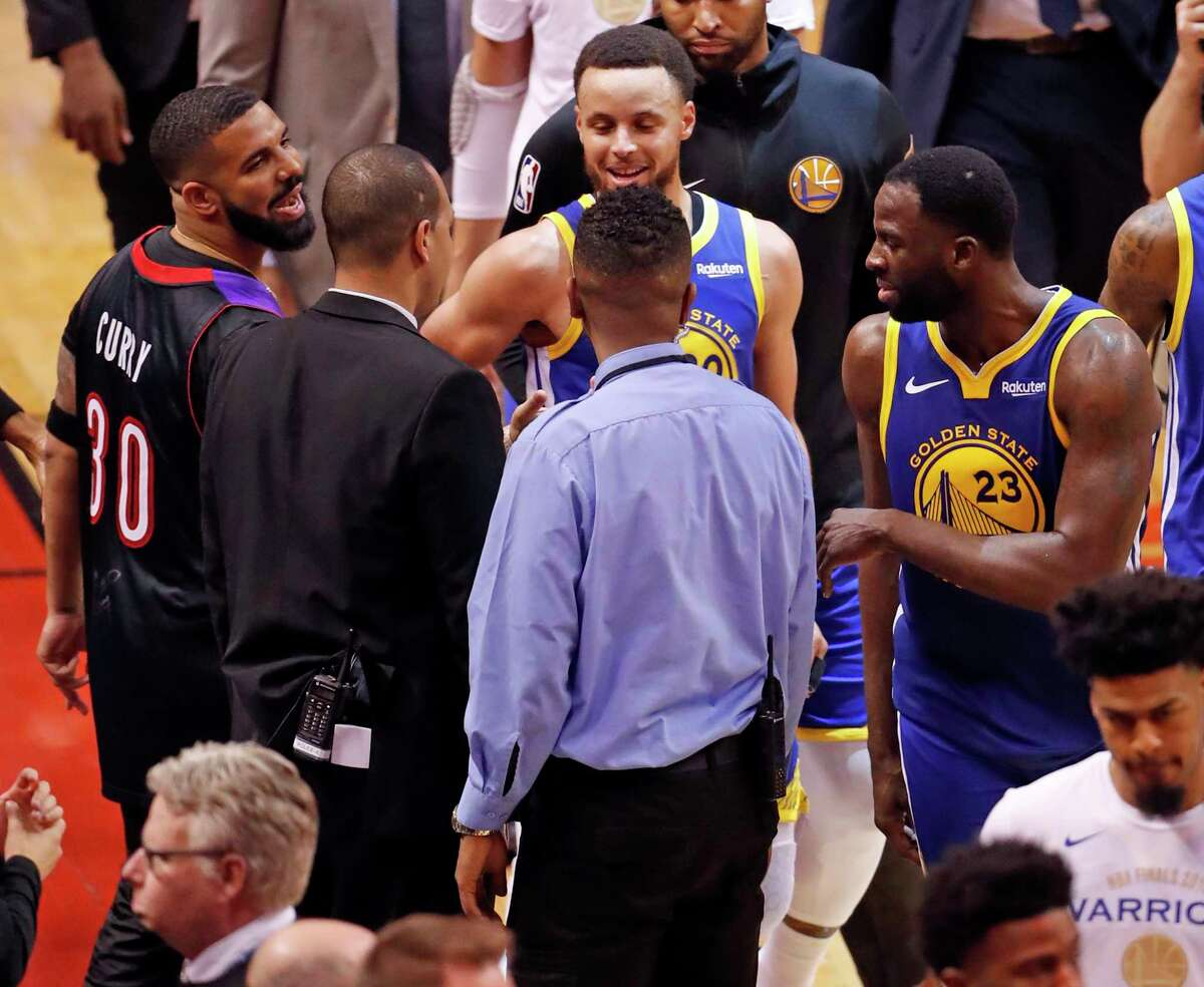 Drake and Golden State Warriors' Draymond Green exchange words after Toronto's 118-109 win in NBA Finals' Game 1 at ScotiaBank Arena in Toronto, Ontario, Canada, on Thursday, May 30, 2019.