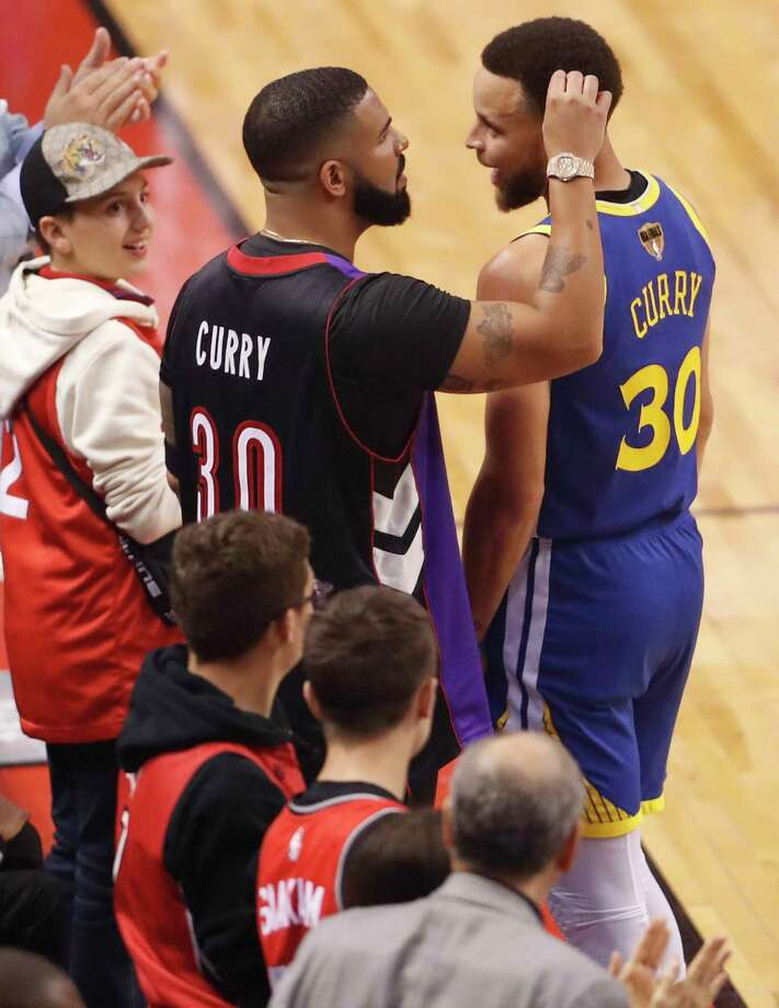 Drake and Golden State Warriors' Stephen Curry exchange pleasantries during Toronto Raptors' 118-109 win in NBA Finals' Game 1 at ScotiaBank Arena in Toronto, Ontario, Canada, on Thursday, May 30, 2019. Photo: Scott Strazzante, The Chronicle / San Francisco Chronicle
