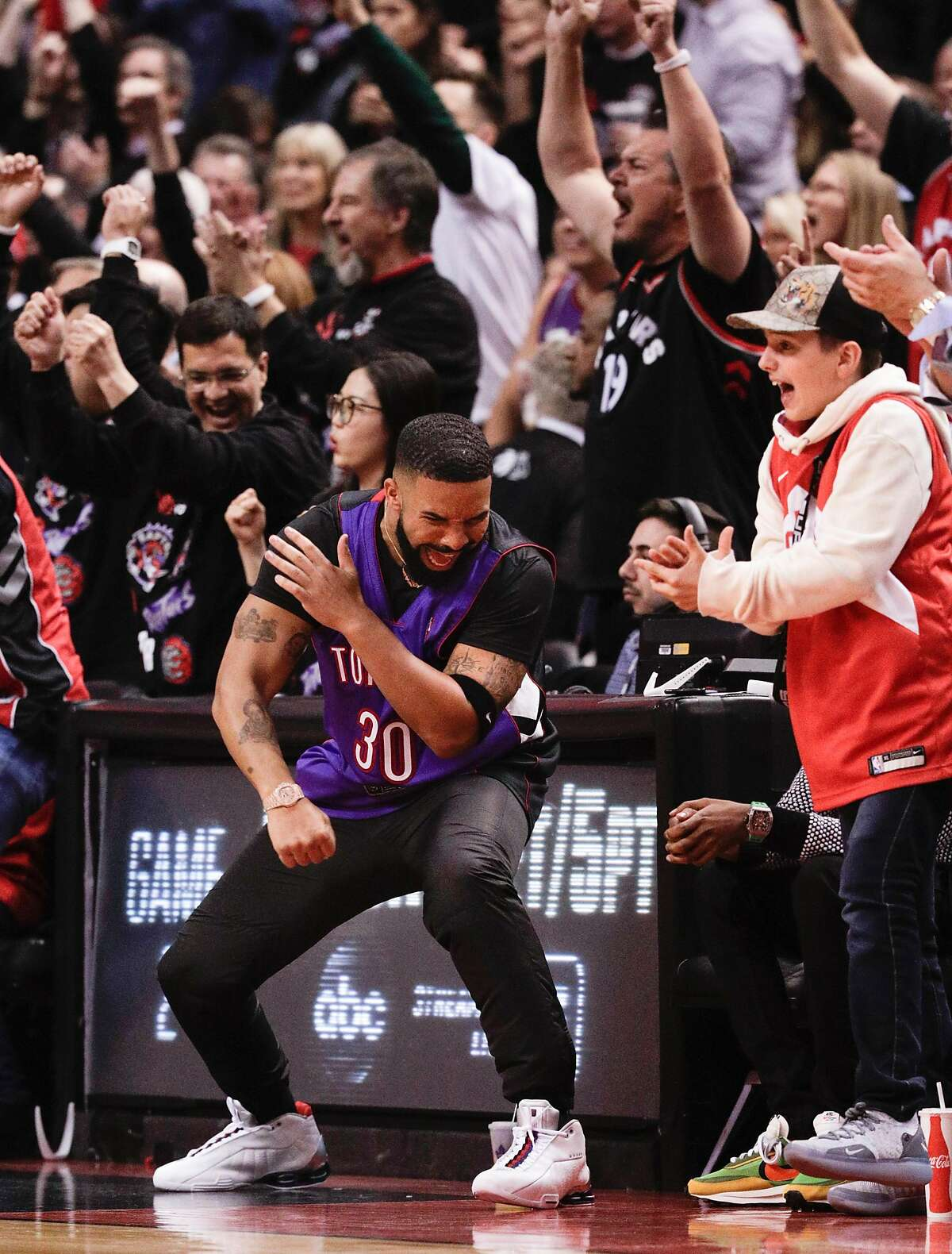 Drake reacts in the second quarter during game 1 of the NBA Finals between the Golden State Warriors and the Toronto Raptors at Scotiabank Arena on Thursday, May 30, 2019 in Toronto, Ontario, Canada.