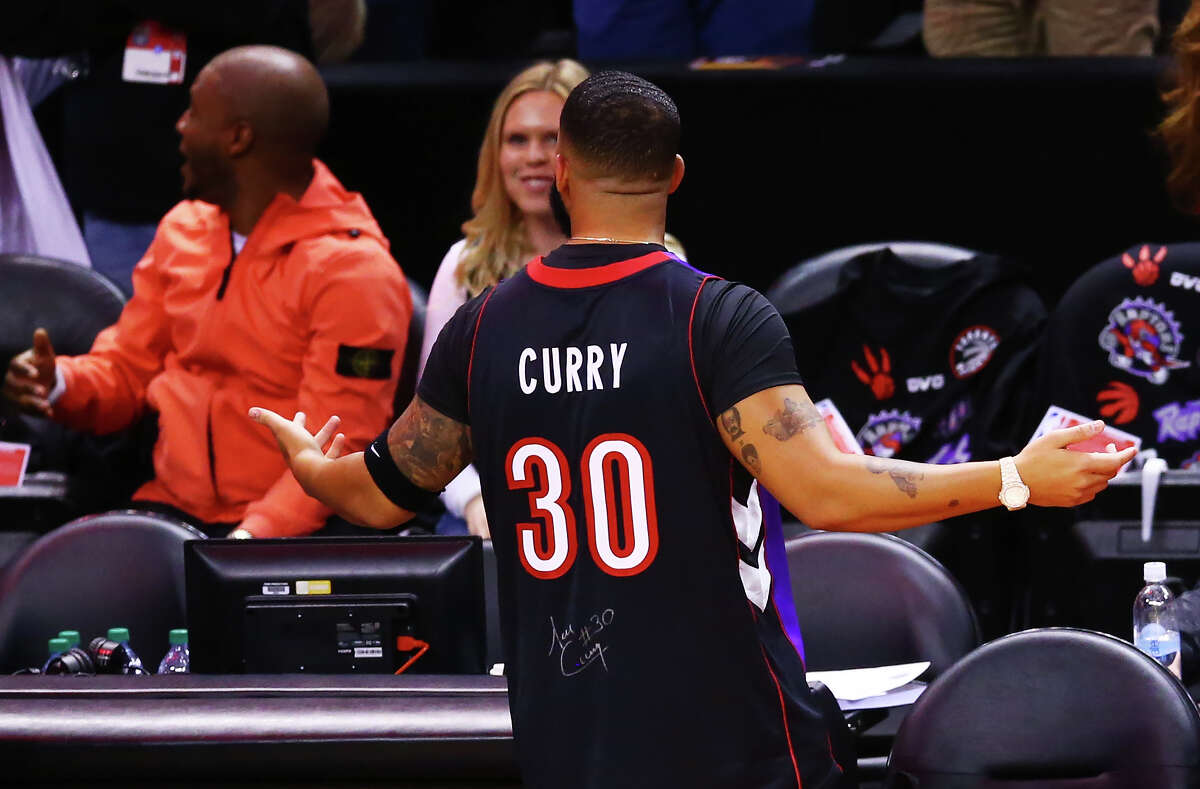 TORONTO, ONTARIO - MAY 30: Rapper Drake is seen wearing a Dell Curry jersey before Game One of the 2019 NBA Finals between the Golden State Warriors and the Toronto Raptors at Scotiabank Arena on May 30, 2019 in Toronto, Canada. NOTE TO USER: User expressly acknowledges and agrees that, by downloading and or using this photograph, User is consenting to the terms and conditions of the Getty Images License Agreement.
