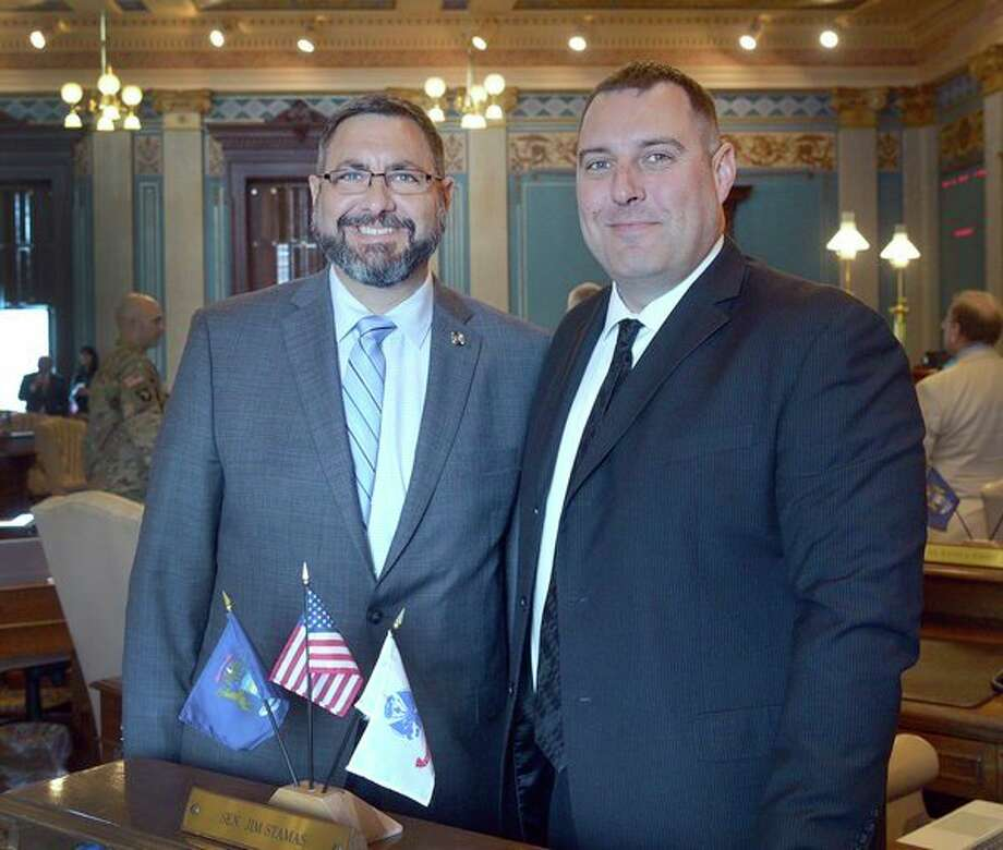 State Sen. Jim Stamas, R-Midland, left, welcomes Sgt. Joseph McLosky from Hope to the state Capitol. (Photo provided)