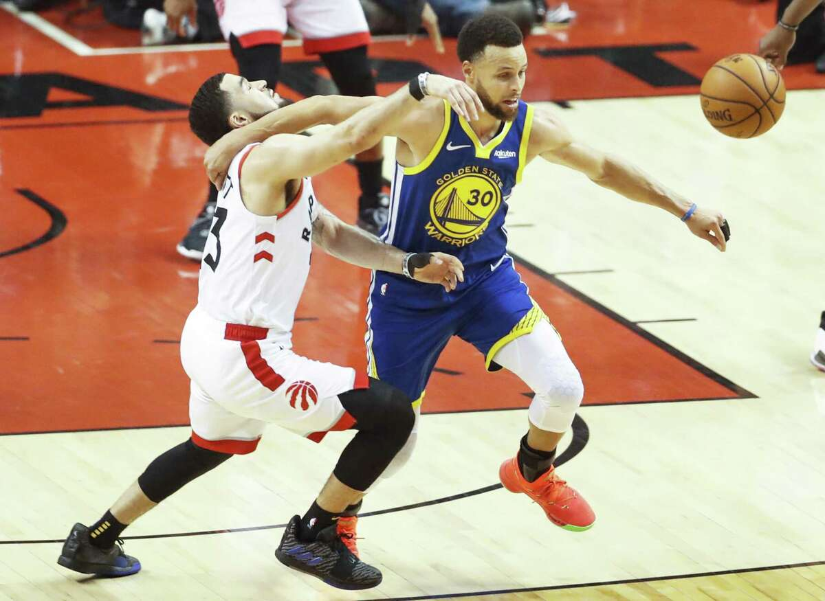 Golden State Warriors' Stephen Curry goes after a loose ball against Toronto Raptors' Fred VanVleet in the second quarter during game 1 of the NBA Finals between the Golden State Warriors and the Toronto Raptors at Scotiabank Arena on Thursday, May 30, 2019 in Toronto, Ontario, Canada.