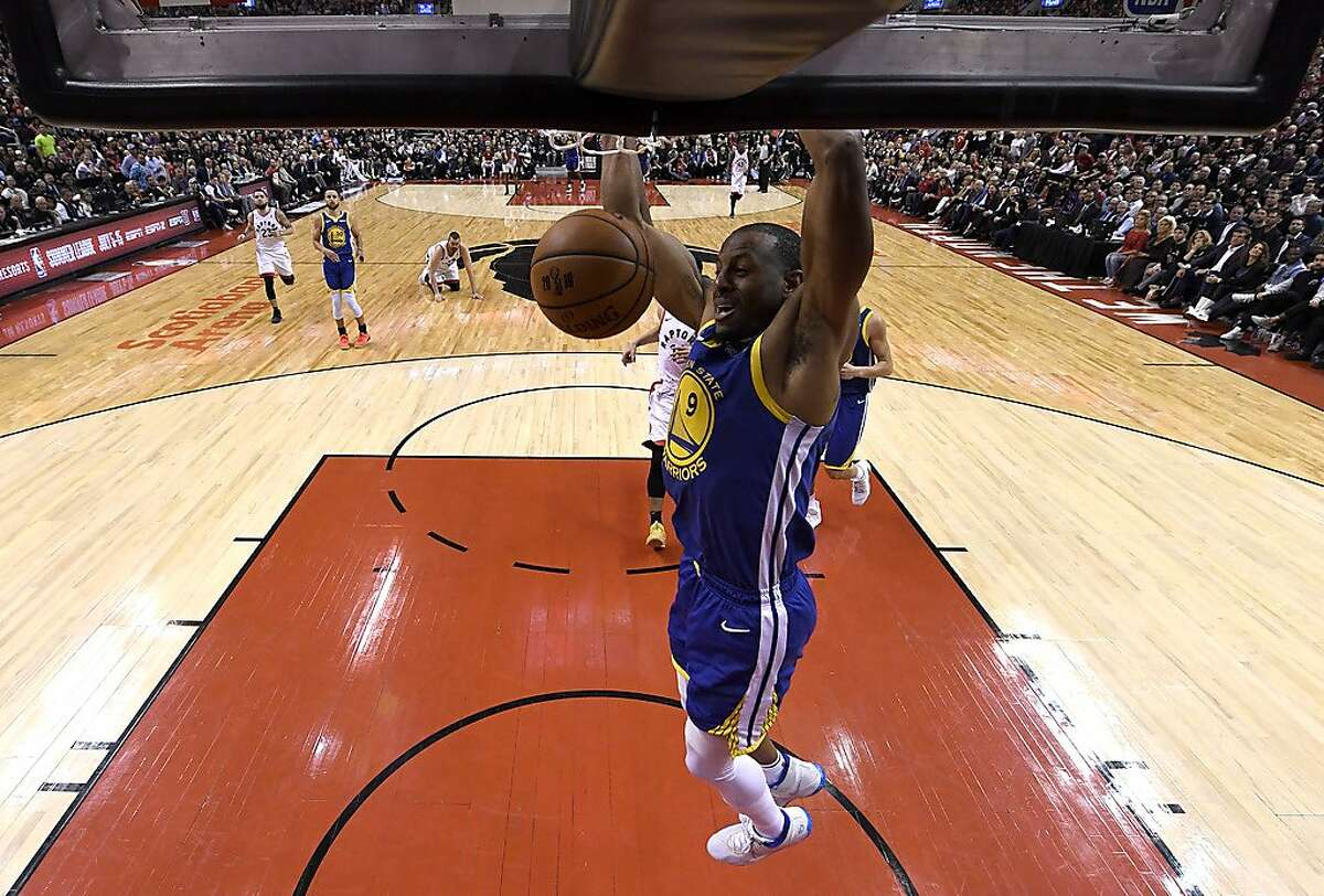 TORONTO, ONTARIO - MAY 30: Andre Iguodala #9 of the Golden State Warriors dunks the ball against the Toronto Raptors in the second half during Game One of the 2019 NBA Finals at Scotiabank Arena on May 30, 2019 in Toronto, Canada. NOTE TO USER: User expressly acknowledges and agrees that, by downloading and or using this photograph, User is consenting to the terms and conditions of the Getty Images License Agreement. (Photo by Kyle Terada - Pool/Getty Images)