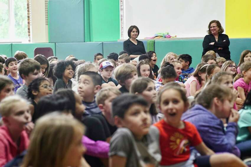 Students listen as runners Diane Nukuri, and Melody Fairchild talk to them during a visit to Elsmere Elementary School on Thursday, May 30, 2019, in Delmar, N.Y. The two runners will compete in the Freihofer's Run for Women race on Saturday. (Paul Buckowski/Times Union)