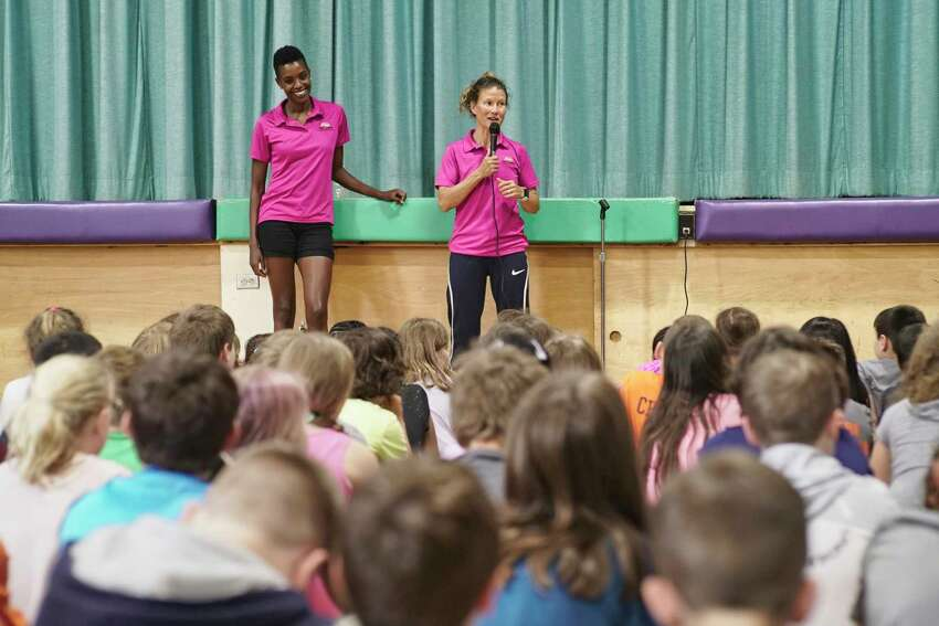 Runners, Diane Nukuri, left, and Melody Fairchild talk to second through fifth graders during a visit to Elsmere Elementary School on Thursday, May 30, 2019, in Delmar, N.Y. The two runners will compete in the Freihofer's Run for Women race on Saturday. (Paul Buckowski/Times Union)