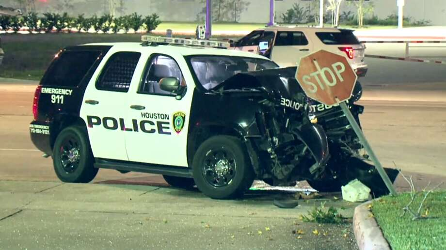 Houston police investigate a crash involving an HPD officer on Friday morning, May 31, near Richmond and West Houston Center Boulevard. A woman and her small child were also hurt in the crash. Photo: Metro Video