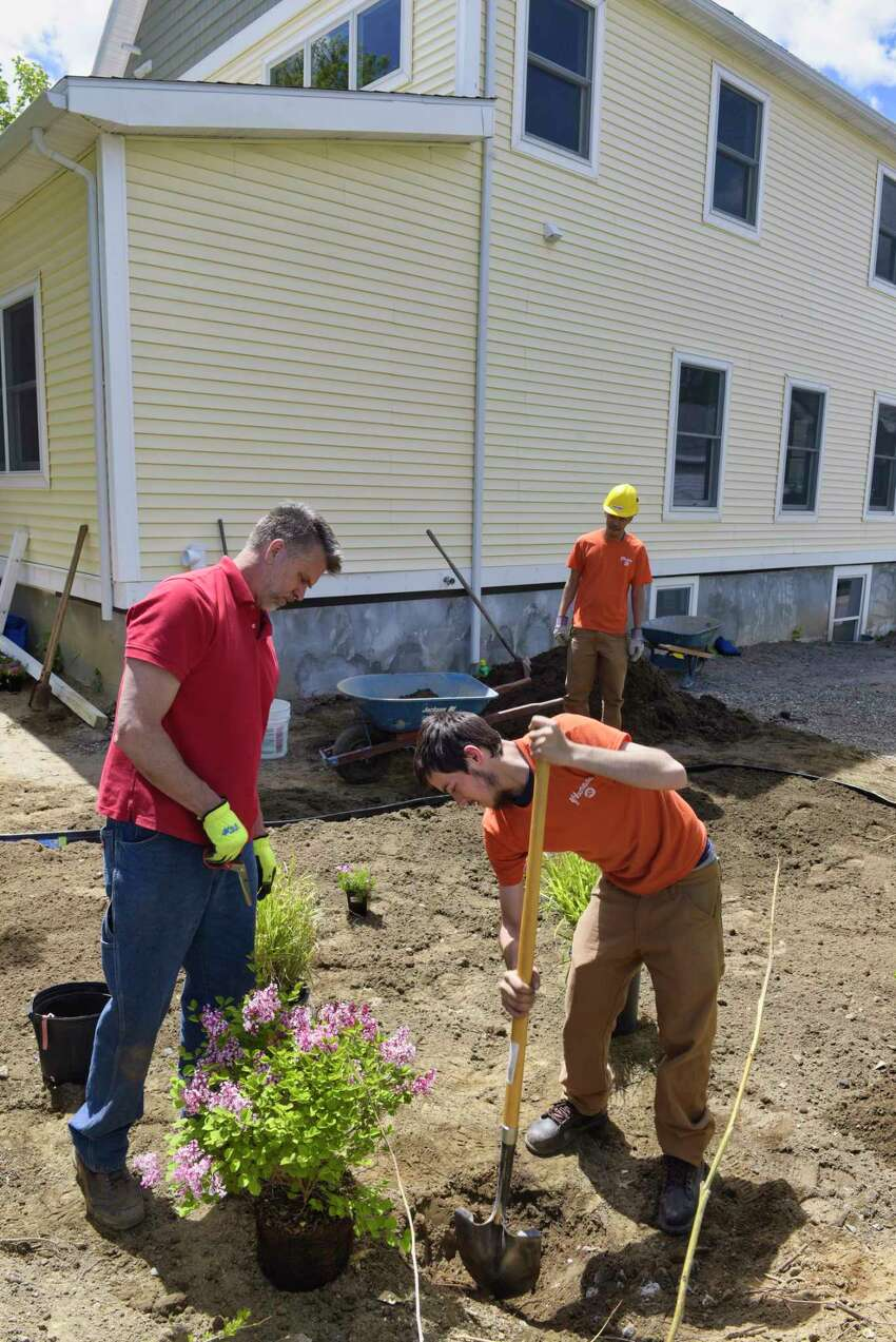 George Brower, left, construction manager for SEAT works with Youth Build's Lucas Marriner, foreground, and Anthony Bellamy, as they construct a rain garden at the Youth Build Affordable Homes project on Tuesday, May 21, 2019, in Schenectady, N.Y. (Paul Buckowski/Times Union)
