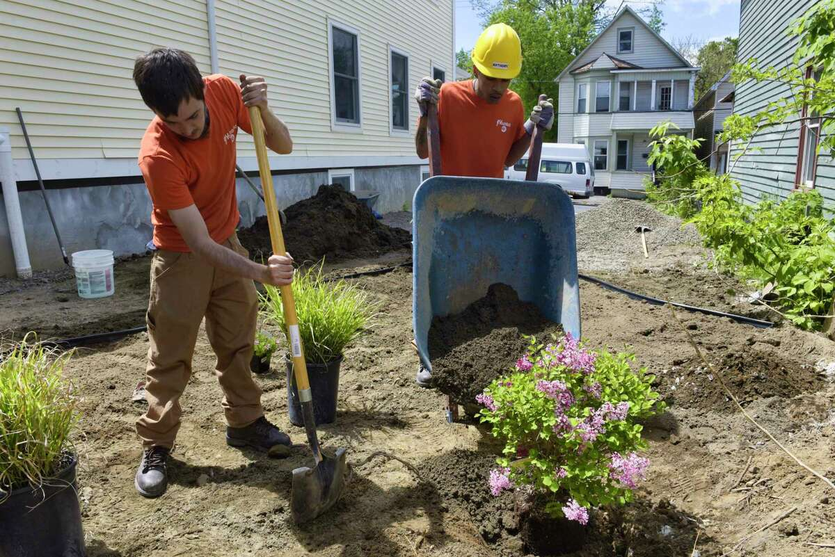 Youth Build's Lucas Marriner, left, and Anthony Bellamy construct a rain garden at the Youth Build Affordable Homes project on Tuesday, May 21, 2019, in Schenectady, N.Y. (Paul Buckowski/Times Union)