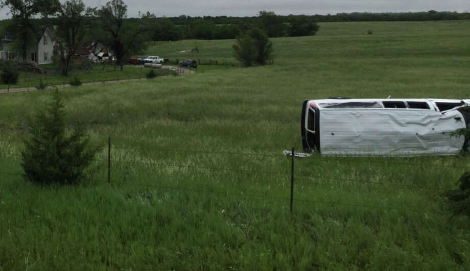 A flipped Silver Line Tour storm-chasing van near Lawrence, Kansas on May 28, 2019. Photo: NOAA Damage Assessment Tool / The Washington Post