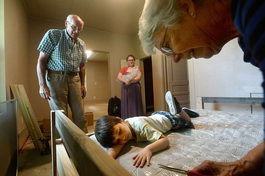 Jack and Charlotte Seely with the newly-formed local chapter of the national non-profit group Sleep in Heavenly Peace and Cristen Lewis (back center) look on as Lewis' son Noah Johnson rests atop hismattress as it inflates at the Lewis' soon-to-be home in Orange. Lewis and her family of five are moving to Orange from their small apartment in Sour Lake and were in need of assistance with getting beds for her two older children, Noah and Kathyleen Edwards, 10 (not pictured). Photo taken Tuesday, May 14, 2019 Kim Brent/The Enterprise Photo: Kim Brent / The Enterprise / BEN