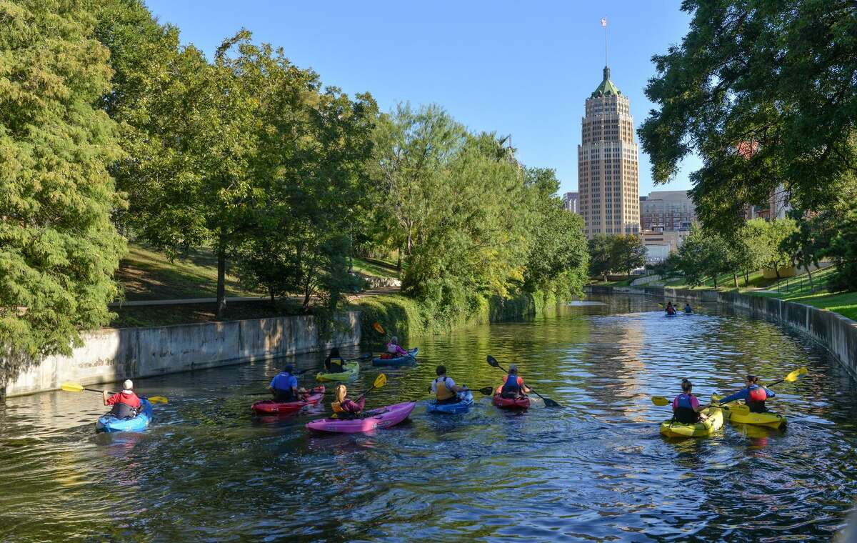 Kayakers paddle along the San Antonio River Sept. 22, 2013 near the King William District. A daylong party Saturday will celebrate the final opening of the $270 million project which will be lauded as a model of ecosystem restoration in an urban environment.