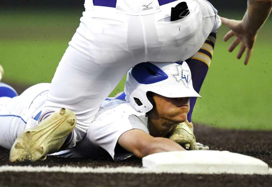 La Vernia's Hunter Homeyer slides in safely beneath Kaden Dydalewicz of Liberty Hill after hitting a triple during Game 1 of Class 4A baseball playoffs action in Dripping Springs on Thursday, May 30, 2019. Photo: Billy Calzada, Staff / Staff Photographer / Billy Calzada