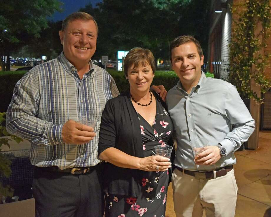 "Gary, Debbie and Matt Lentz at the Meals on Wheel Montgomery County Cigars Under the Stars fundraiser ""Savannah Nights"" Photo: Photo Courtesy Margie Taylor"