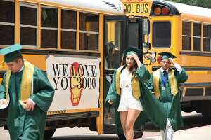 Students walk out of buses and walk towards the arena with their classmates during Nixon High School'sgraduation at Sames Auto Arena, Thursday, May 30, 2019.