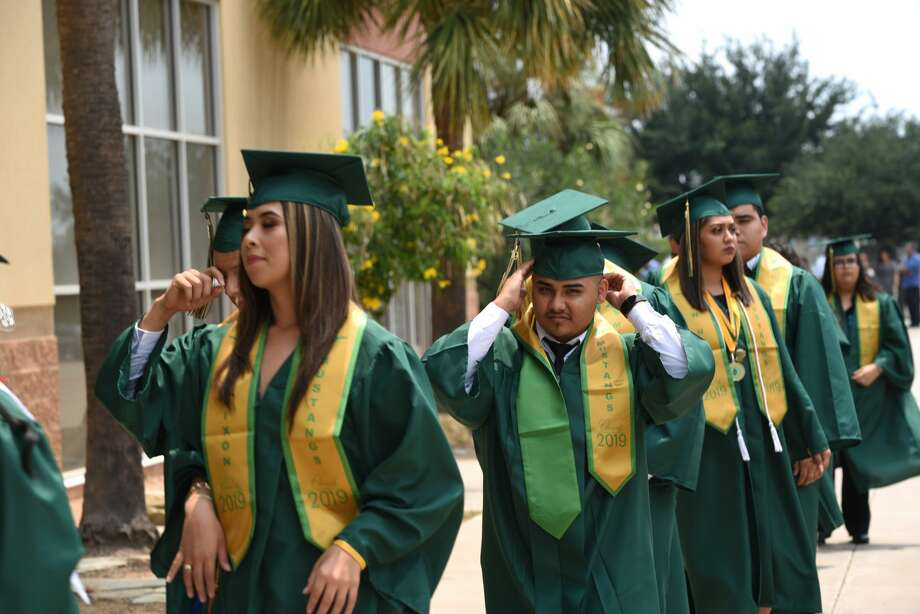 Students walk out of buses and walk towards the arena with their classmates during Nixon High School's graduation at Sames Auto Arena, Thursday, May 30, 2019. Photo: Christian Alejandro Ocampo