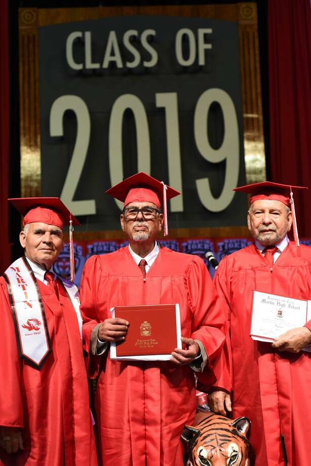 U.S. Veterans Miguel Romo, Dogberto Carmona and Roque Vela Sr. stand with their High School degrees during Martin High School's graduation at Sames Auto Arena, Thursday, May 30, 2019. Photo: Christian Alejandro Ocampo